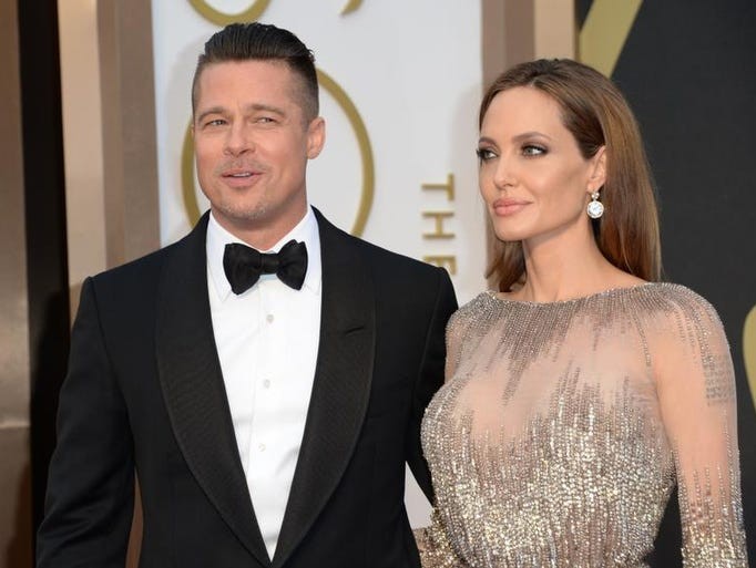 Actors Brad Pitt and Angelina Jolie arrive on the red carpet for the 86th Academy Awards on March 2nd, 2014 in Hollywood, California. AFP PHOTO / Robyn BECKROBYN BECK/AFP/Getty Images