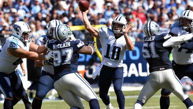Titans quarterback Jake Locker throws against the Dallas Cowboys on Sept. 14.