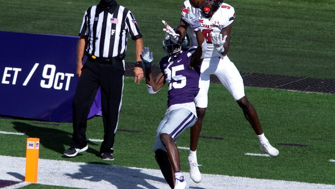 Kansas State cornerback Ekow Boye-Doe (25) breaks up a pass intended for Texas Tech receiver T.J. Vasher (9) during the Wildcats' 31-21 victory Saturday in Manhattan, Kansas.