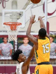 University Height's Dekeyvan Tandy (15) shoots over