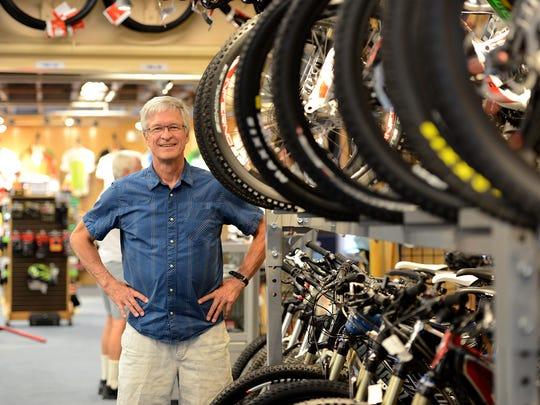 Zandy Wheeler, co-owner of Skirack, stands on the bike