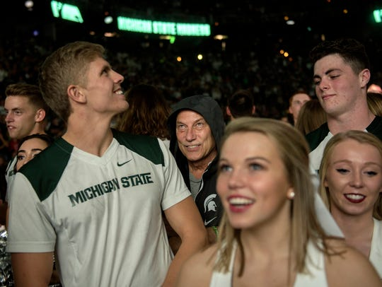 Michigan State head coach Tom Izzo hides among the