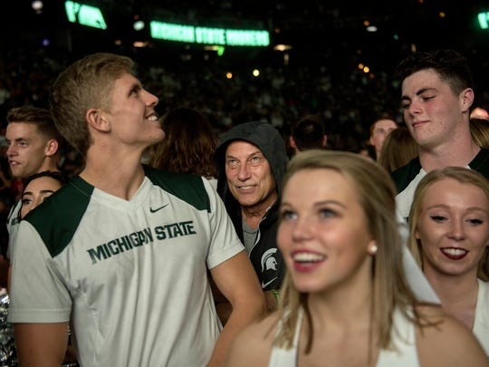 Michigan State head coach Tom Izzo hides among the cheerleaders before his costume reveal during the annual Midnight Madness event on Friday, Oct. 20, 2017, at the Breslin Center in East Lansing.