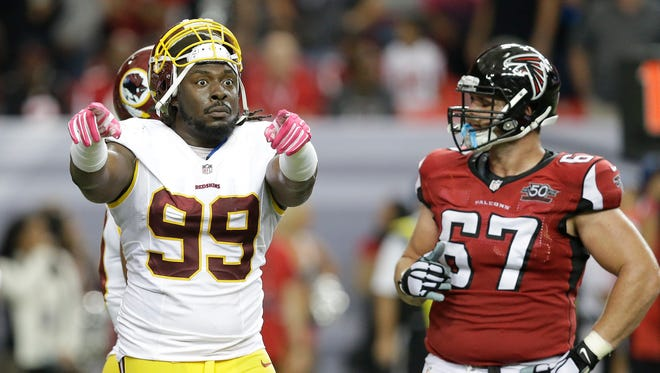Washington Redskins defensive tackle Ricky Jean Francois (99) gestures to the bench against the Atlanta Falcons on Oct. 11, 2015, in Atlanta.