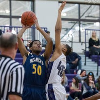 Ahmed McKinney of Battle Creek Central takes a shot under pressure from DaLeon Graham of Lakeview in action earlier this season. Both BCC and Lakeview will play in a Class A district at Loy Norrix.