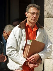 In this 1996 file photo, Thomas Capano leaves Superior Court in Wilmington after being sentenced to death for the murder of Anne Marie Fahey. Capano, a once wealthy and politically connected attorney serving life in prison for killing Fahey, was found dead in his prison cell on Sept. 19, 2011.