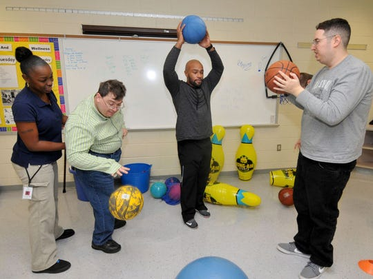 Bancroft staff and day program participants enjoy indoor sports activities.