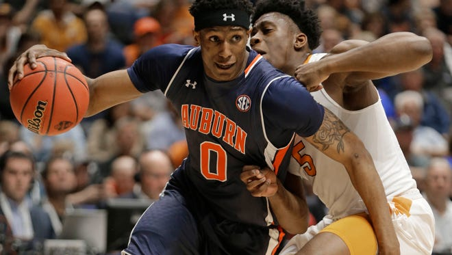 Auburn's Horace Spencer (0) drives against Tennessee's Admiral Schofield (5) during the first half of an NCAA college basketball game in the Southeastern Conference tournament in Nashville, Tenn., Wednesday, March 9, 2016.