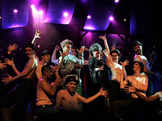 """Pippin (Christian Winter) and Berthe (Betty Hukill) join a pose capping off """"No Time at All"""" with the ensemble members of the Historic Paramount Theatre's production of """"Pippin."""" The show opens Friday for three performances this weekend"""