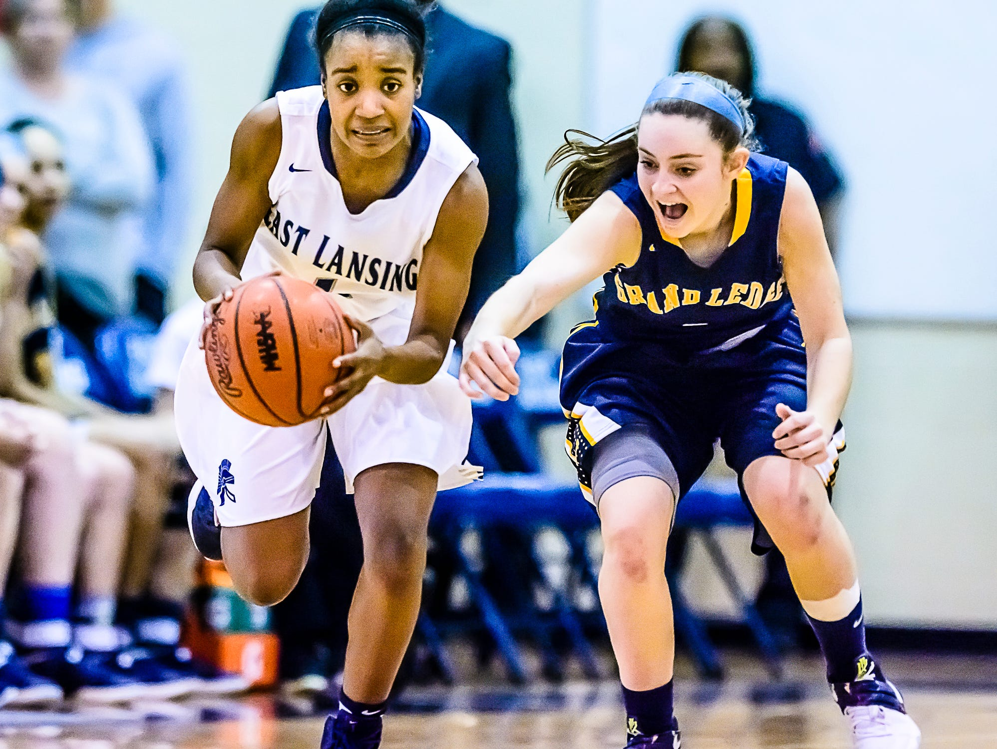 Sanaya Gregory ,left, of East Lansing steals the ball from Mackenzie Todd of Grand Ledge during their district semifinal game Wednesday March 1, 2017 at East Lansing High School. KEVIN W. FOWLER PHOTO