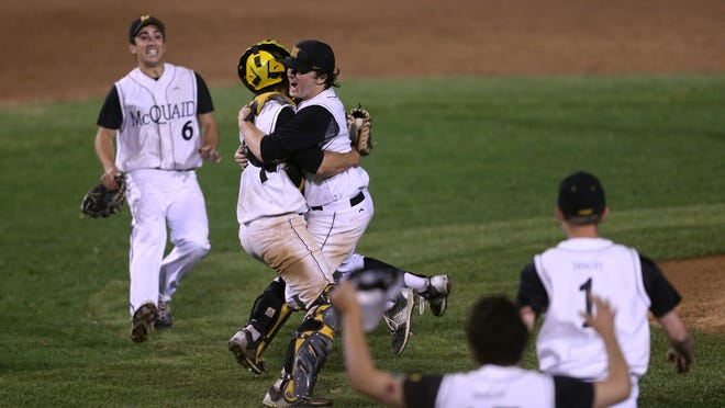 McQuaid pitcher Henry Buholtz is congratulated by catcher Jeff Weber after throwing a no-hitter in a 2-0 win over Rush-Henrietta for the Class AA championship.