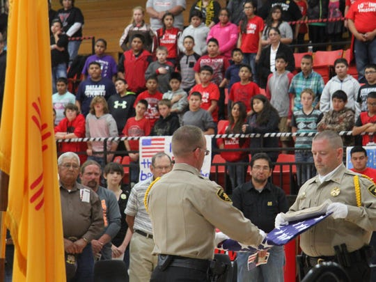 The Eddy County Sheriff's Color Guard presents the flag at the Loving High School Veterans Day celebration.