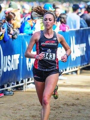 Livonia native and former Michigan State runner Rachel McFarlane ran 1:14:45 at the 2014 Detroit Free Press Half-Marathon.