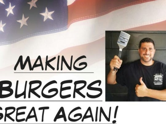 Mike Maur, owner of the Burger Inn, Melbourne, takes advantage of a recent political slogan.