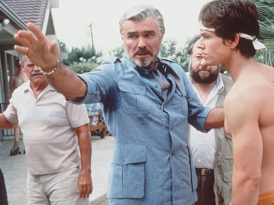 "Burt Reynolds directs Mark Wahlberg (Dirk Diggler) in a scene of the movie ""Boogie Nights.""  Reynolds won numerous awards for his portrayal of (Jack Horner) in the film."