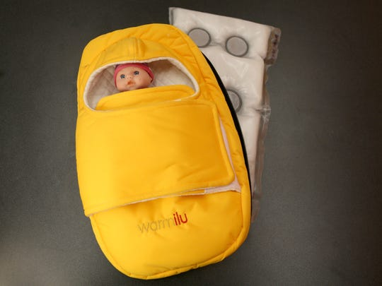 A toy doll about the size of a premature baby shows what the Warmilu warming blanket can do to keep babies warm in third-world countries.