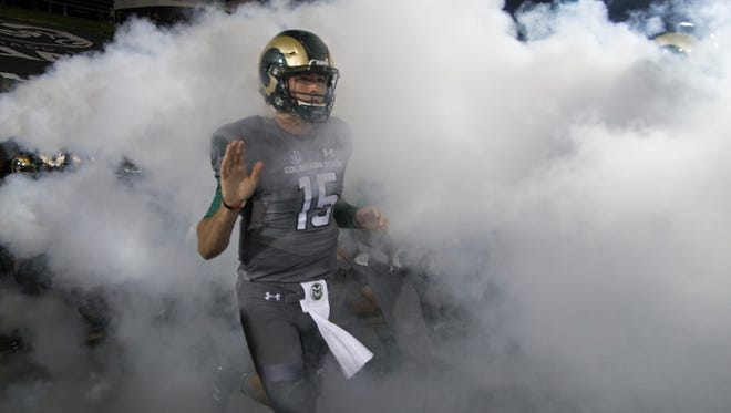 CSU quarterback Collin Hill runs out of the tunnel at Hughes Stadium before last Saturday night's game against Wyoming. The Rams will host Utah State this Saturday night at Hughes.