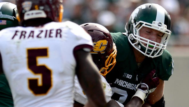 MSU tight end Paul Lang (83) tries to break a couple of tackles on his 9-yard, first-down catch against Central Michigan on Saturday during the Spartans 30-10 win over the Chippewas.