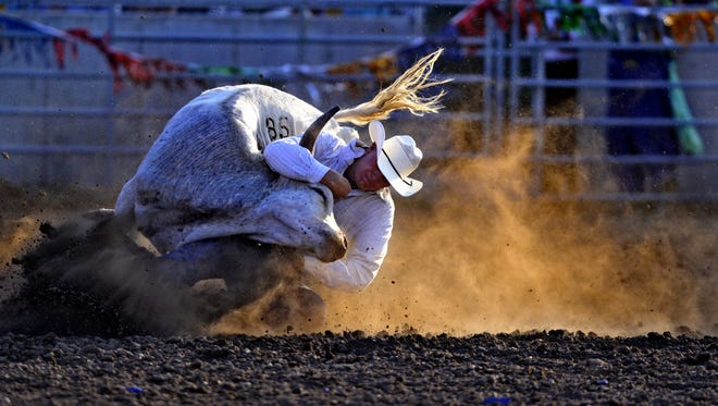 Shawn Downing competes in the steer wrestling event at a previous Central Montana Fair PRCA Rodeo.