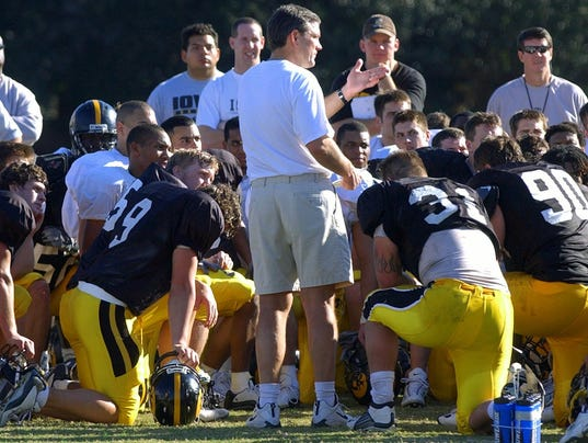Kirk Ferentz talks to his players 2003