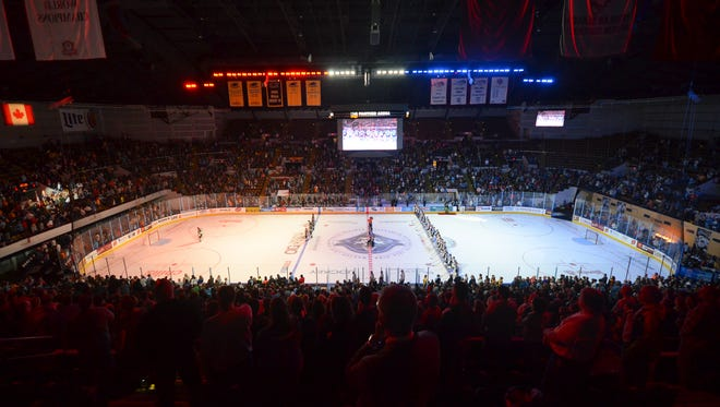 The UWM Panther arena is bathed in red, white and blue for the national anthem at the Milwaukee Admirals' home opener Saturday, October 29, 2016, at the UWM Panther Arena.