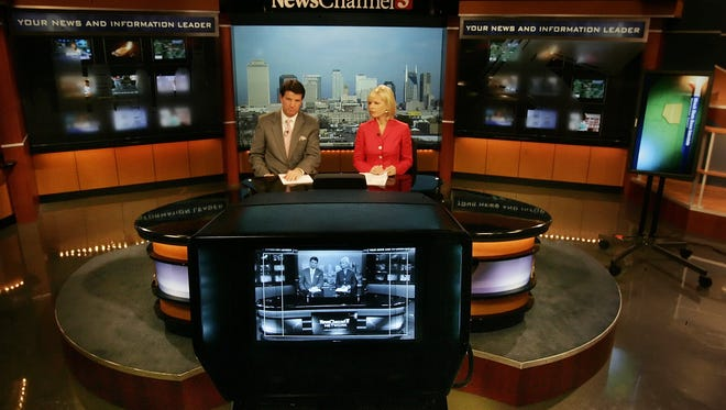 in 2007, Steve Hayslip, no longer at WTVF, and Amy Watson rehearse on the set of NewsChannel5.