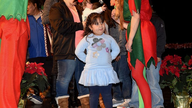 Sophia Baca, 4, waits patiently at the front of the line to see Santa during the Miracle on Main Street on Dec. 4, 2016, at the Farmington Civic Center.