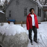 Beth Kimmel of Dixboro  with the propane tank used for heating her home. Customers felt the hardships of rising prices last winter and filed complaints about alleged overcharging. Michigan Attorney General Bill Schuette got some results on the alleged price-gouging this week.