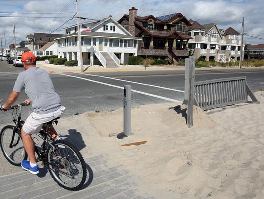 A bicyclist rides past the location of the bombing