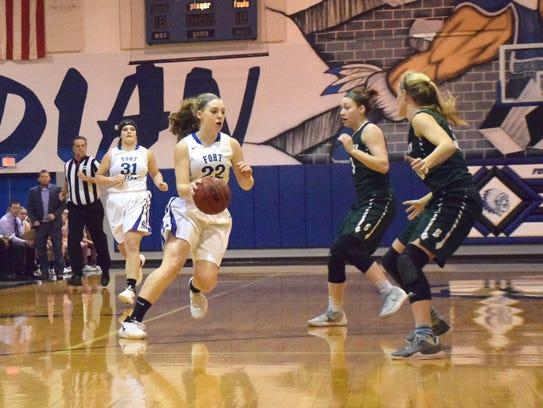 Fort Defiance's Catie Cramer brings the ball across