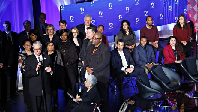 Des Moines Mayor Frank Cownie speaks before the start of the Brown & Black Democratic Forum at Drake University Monday, Jan. 11, 2016. Next to him at front and center are forum co-founders Wayne Ford (standing) and Mary Campos (seated).