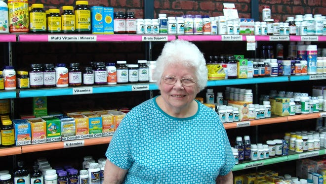 Marilyn Wiley stands in the vitamins aisle at her shop, Marilyn's Natural Foods health food store at 430 Main St.