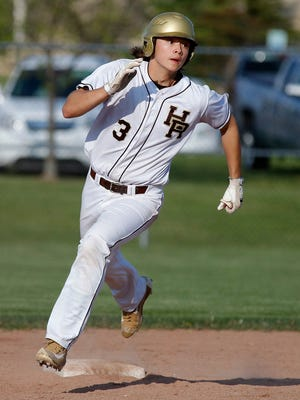 Holt's Jesse Heikkinen rounds the bases after hitting a double against Grand Ledge Thursday, May 19, 2016, in Holt, Mich. Grand Ledge won 4-3 in the first game and 6-1 in the second.