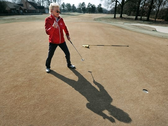 Betty Tucker celebrates making a long putt on the second green at Lakeland's Stonebridge Golf Club on Monday afternoon, Jan. 29, 2018.
