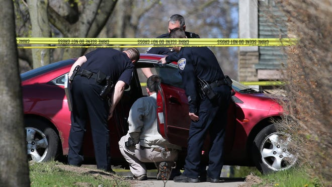 Rochester police investigate a homicide on Post Avenue involving a man believed to be in his 20s. The body was found in the front seat of the car with the driver side window shot out April 29, 2015.