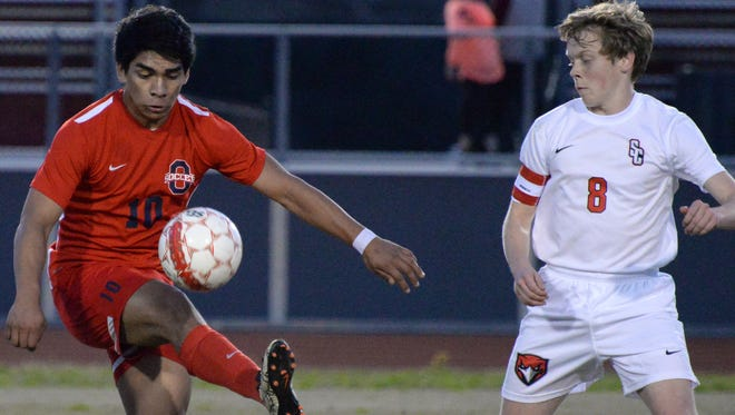 Oakland's Jorge Hernandez tries to gain control of the ball while Stewarts Creek's Daniel Snyder defends during the Patriots 3-1 win on Tuesday night.