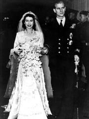 FILE - In this Nov. 20, 1947 file photo, Britain's Princess Elizabeth leaves Westminster Abbey in London, with her husband, the Duke of Edinburgh, after their wedding ceremony. Britain's Queen Elizabeth celebrates her 91st birthday on Friday, April 21, 2017.