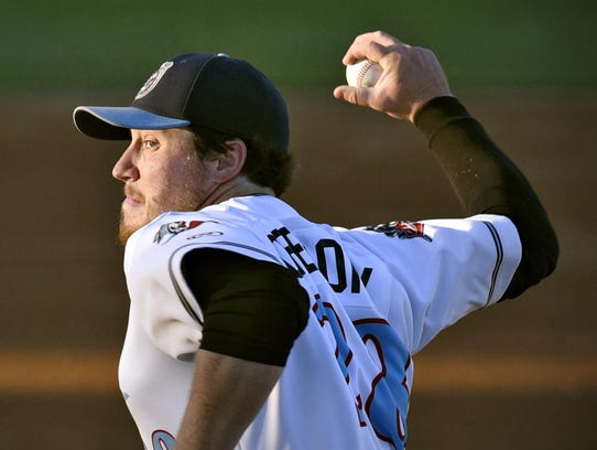 St. Cloud pitcher Reese Gregory winds up to throw to