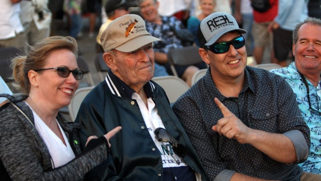 Longtime fishing guide Doug Bird, center, was inducted last week into the Saltwater Legends Hall of Fame during a ceremony attended by nearly 200 well wishers at Marker 37 Marina.