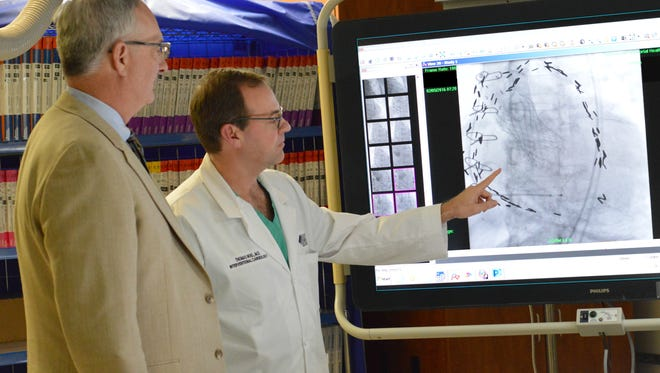 Dr. David Saint, left, and Dr. Thomas Noel work together as part of TMH's Structural Heart Program