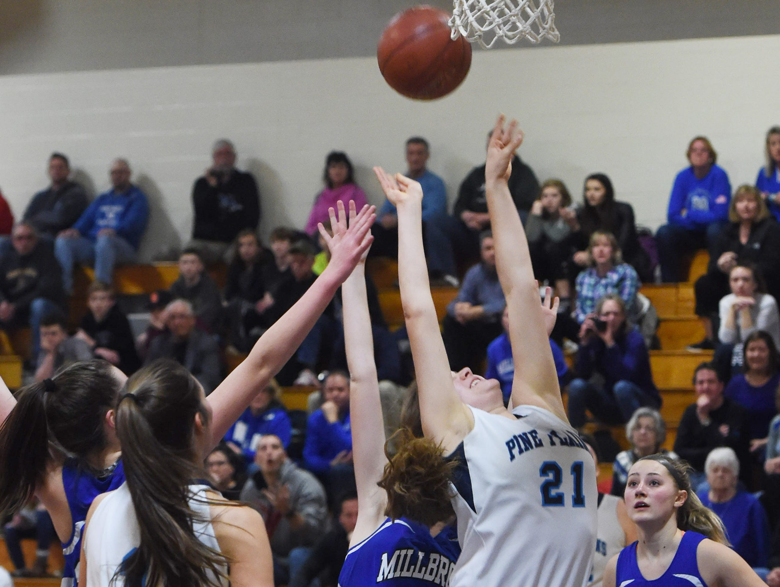 Pine Plains' Isabella Starzyk, center, goes for a layup during Friday's Section 9 championship game against Millbrook at Mount Saint Mary College in Newburgh.