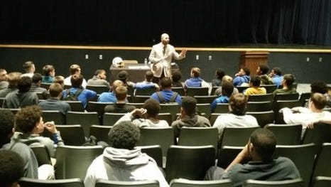 Lee Johnson, standing, will be the head varsity football coach of the Knights, pending approval by the Northwest Local School District Board of Education. He met with the team Feb. 5.