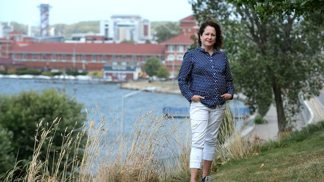 Brenda Sandberg, executive director of the Erie-Western Pennsylvania Port Authority, is shown Thursday at Bayview Park in Erie. The Port Authority has a new policy for maintaining the bluffs that will preserve waterfront views and prevent erosion.