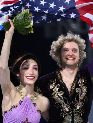 The United States' Charlie White and Meryl Davis celebrate their ice dancing gold medal.