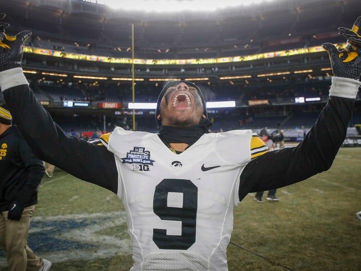 Iowa freshman safety Geno Stone celebrates a 27-20