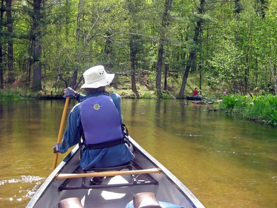 The Mecan River, which flows clear and cold over a sandy streambed, is rich with fish and wildlife sightings.