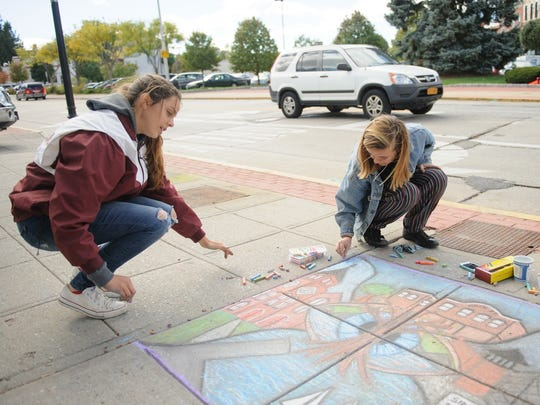 Ossining artists Zoe Supina and Melissa Twomey received first place at the Village's Chalk It Up! festival last year.