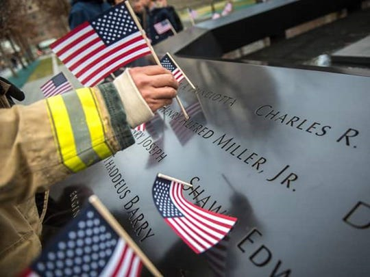 Gallatin firefighter Mario Mendoza places an American flag in honor of NYFD firefighter Henry Miller Jr. who was killed on 9/11. Mendoza participated in the second annual New York City Firefighter Stair Climb in Miller's honor on March 13.