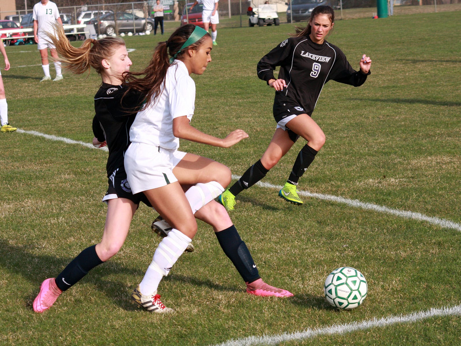 Lakeview's Ava Cook and Pennfield's Sonata Beasley battle for the ball in action earlier this season.