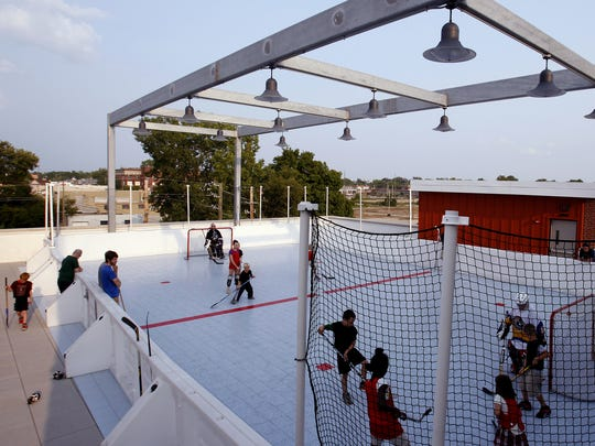 Youth hockey night on the roof of Englewood Christian Church in Indianapolis on July 31, 2014.